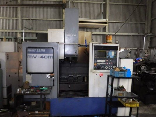 "Mori Seiki"" Cnc Machining Center Model: MV-40M Year 1993 Control  MF-M4(Fanuc  OMC) Work table size: 900x450 mm X axis travel: 560 mm Y axis trav..."