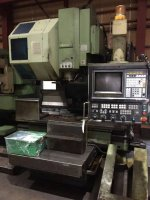"""Okuma"" Machining Center MC-5VA Year 1987 Controller : OSP5000M-G Table Size : 1300mm x 510mm Stroke : X1050mm Y510mm Z560mm BT-50  20-ATC"
